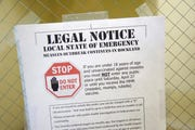 A sign explaining the local state of emergency is displayed at the Rockland County Health Department in Pomona, N.Y.