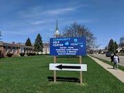 A help center sign outside Bethel United Methodist Church.