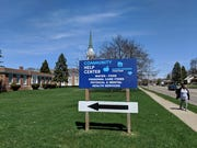 A help center sign outside Bethel United Methodist Church.