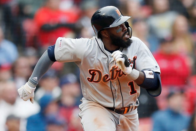 The Detroit Tigers' Josh Harrison watches his two-run double during the eighth inning of the first game Tuesday.