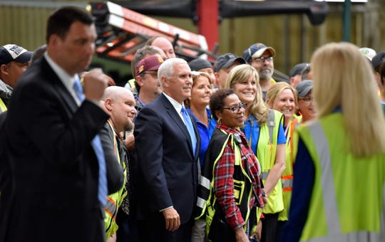 Vice President Mike Pence poses for a group shot with workers before leaving the Dearborn Truck Plant on Wednesday.