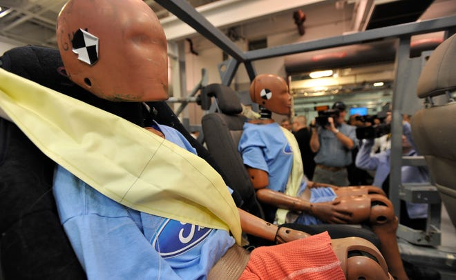 Crash test dummies are seated in the second row of Ford's servo sled crash tester in this Nov. 5, 2009, file photo. Automakers need to develop better safety-restraintsfor backseat passengers, according to a recent study of real-world crashesconducted by the Insurance Institute for Highway Safety.