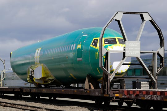 A Boeing 737 fuselage, eventually bound for Boeing's production facility in nearby Renton, Wash., sits on a flatcar rail car at a rail yard in Seattle.