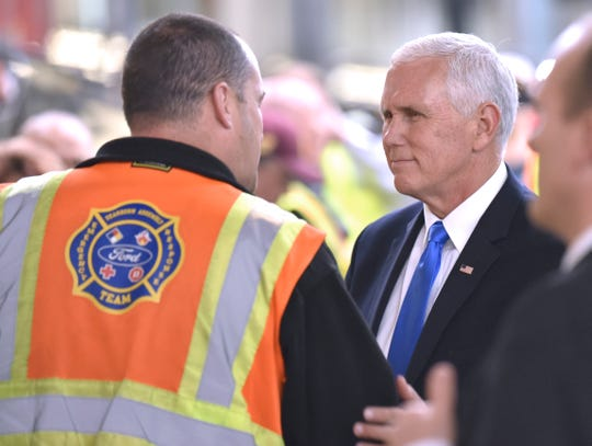 Vice President Mike Pence talks with an auto worker during his tour of the Ford Dearborn Truck Assembly Plant.
