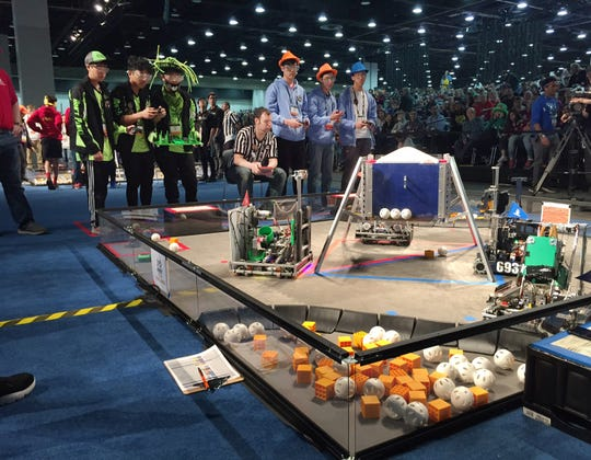 Robotics teams compete in the FIRST Tech Challenge qualifying rounds at Cobo Center in Detroit on Wednesday.