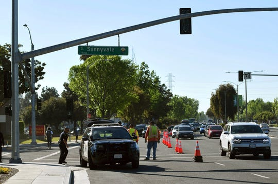 Police investigate the scene of car crash  in Sunnyvale, Calif., on Wednesday, April 24, 2019. Authorities say the driver of the car was taken into custody after he appeared to deliberately plow into the group.