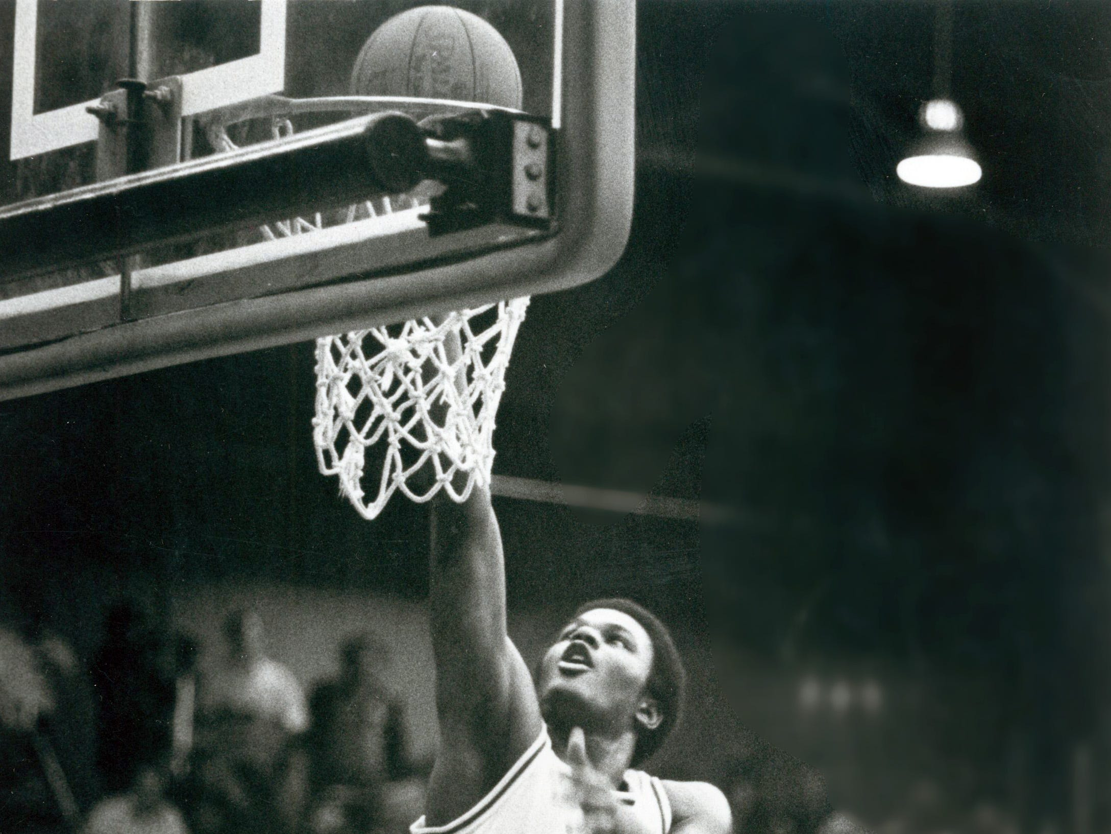 Brian Miles goes up for two points in a game at North High School.