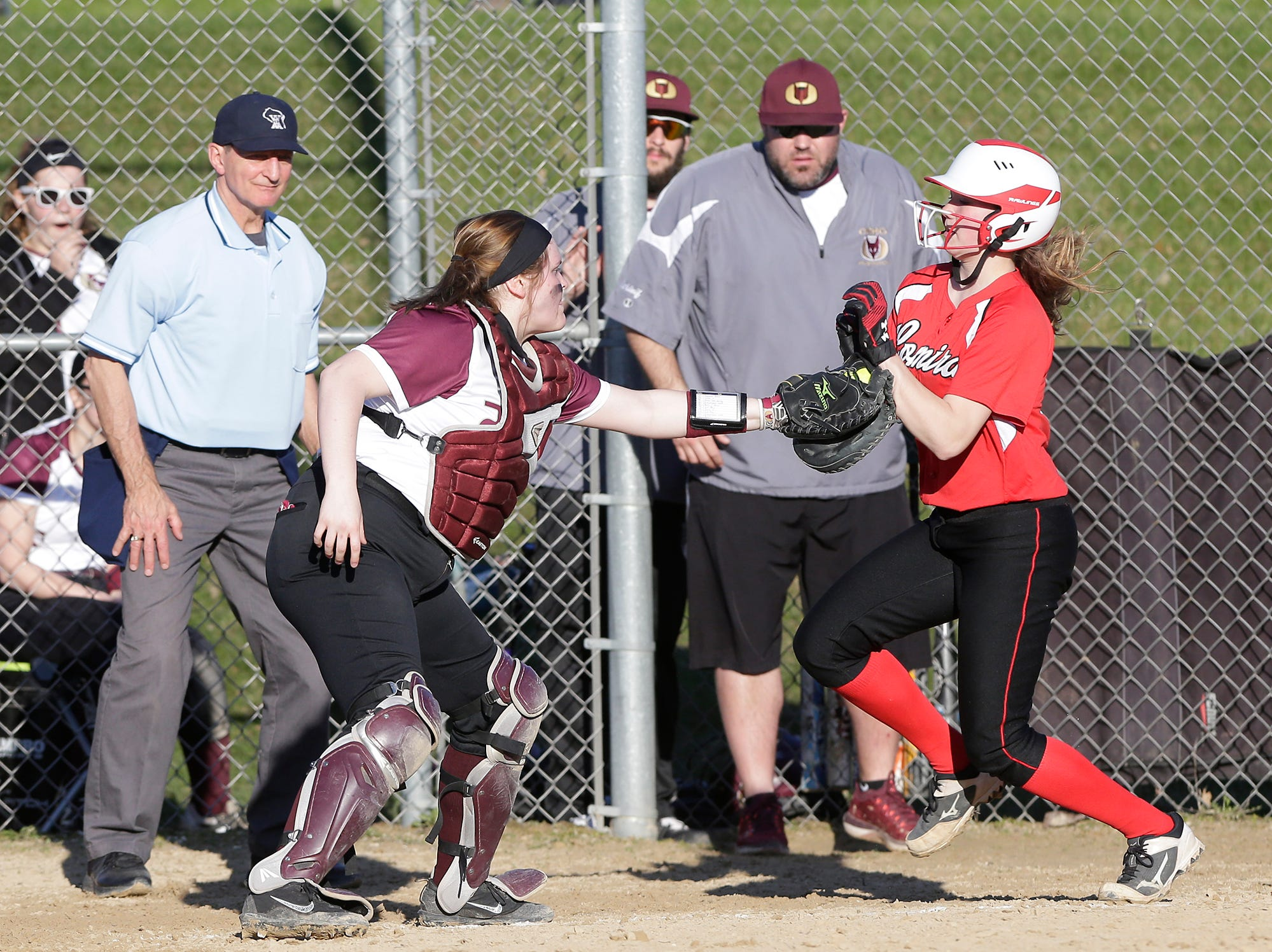 Omro High School softball's LeAnn Steinmates tags out a Lomira High School player during their game Tuesday, April 23, 2019 in Lomira, Wis. Doug Raflik/USA TODAY NETWORK-Wisconsin
