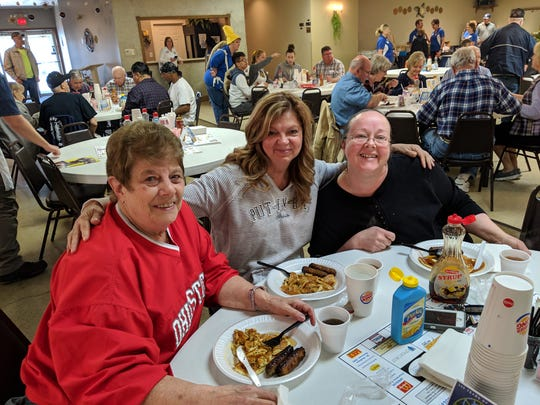 Jane Albert, near, Becky Boldery, middle, and Tammy Rhoad, far, eating at the Kiwanis Pancake Festival Wednesday.