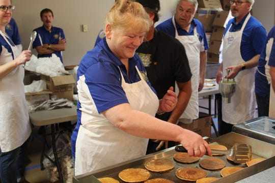 Peggy McQuistion flips pancakes Wednesday during the 60th annual Kiwanis Pancake Festival.