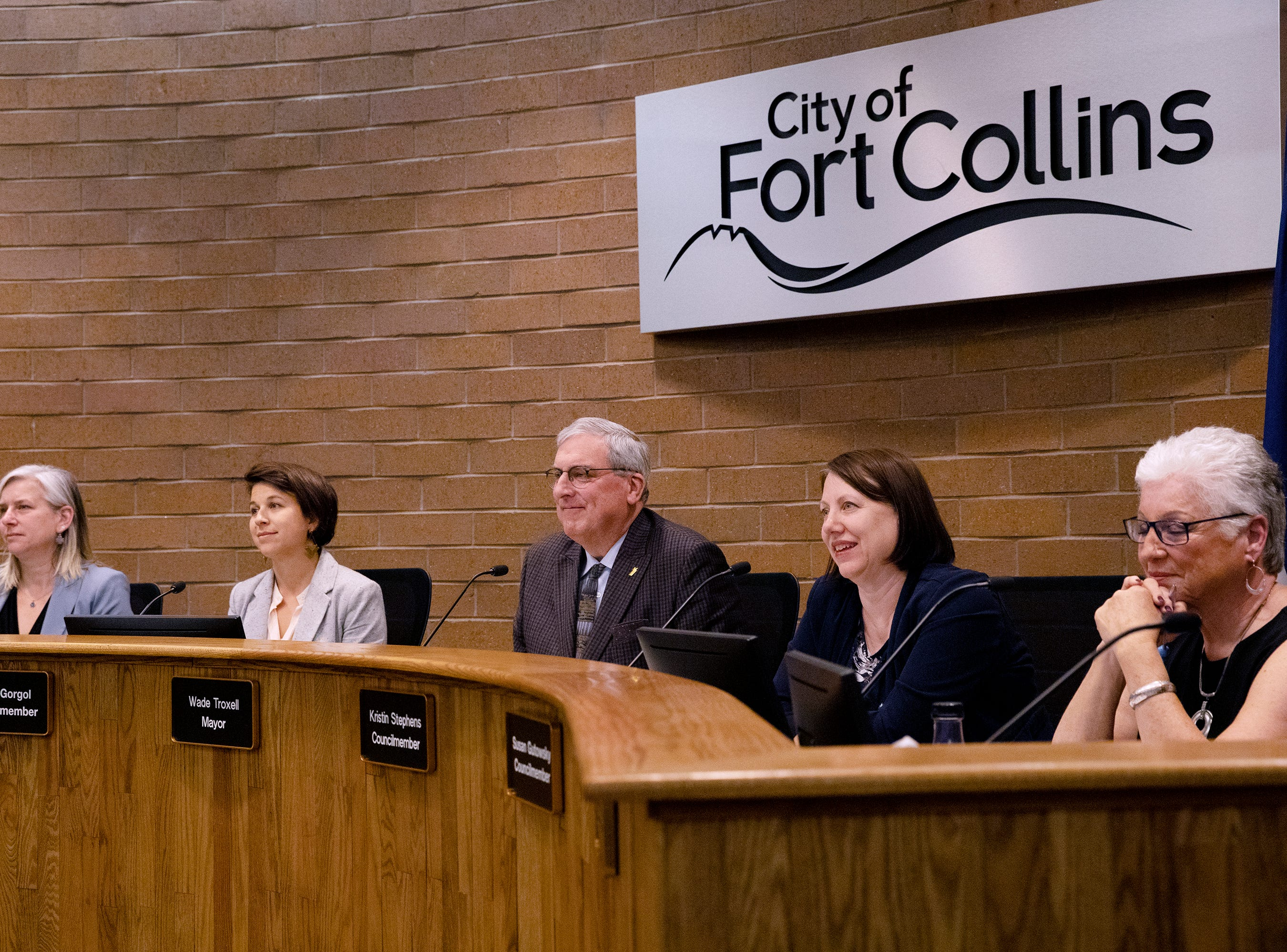 From left, council members Julie Pignataro, Emily Gorgol, Mayor Wade Troxell, Kristin Stephens and Susan Gutowsky take to the bench Tuesday, April 23 at City Hall. Not pictured are council members Ken Summers and Ross Cunniff.