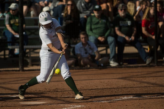 Lauren Buchanan, shown connecting on a pitch during a win Tuesday over Northern Colorado, and the CSU softball team will play their final home game of the season at noon Sunday against San Diego State. The Rams lead the Mountain West and are ranked No. 25 in the nation.