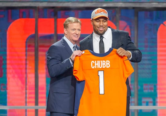 NFL commissioner Roger Goodell poses with linebacker Bradley Chubb, the Denver Broncos' first-round pick and No. 5 selection overall, at the 2018 NFL draft in Arlington, Texas.