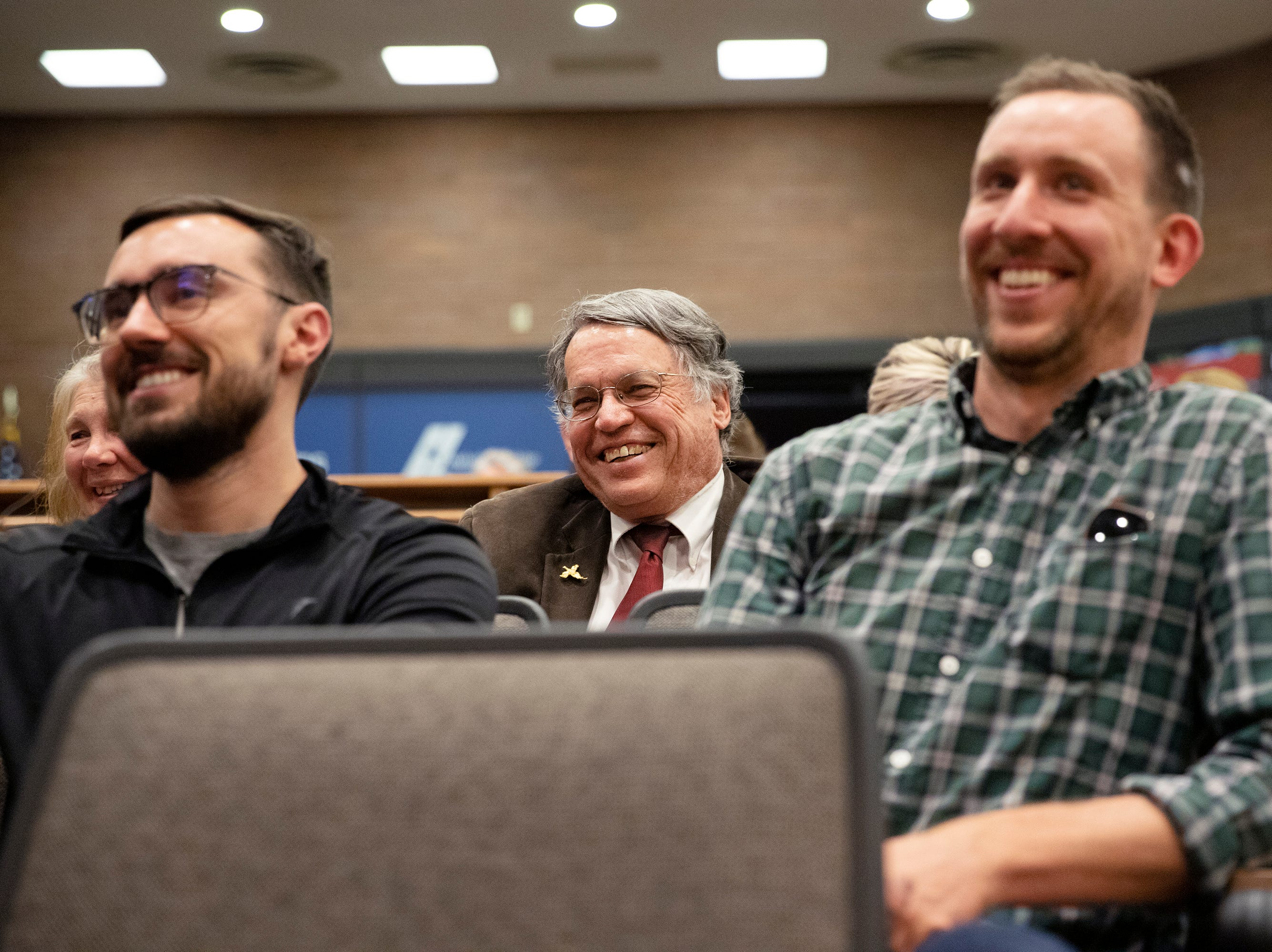 Former council member Gerry Horak, center, laughs as his colleagues share stories and thank him for his service to the community on April 23 at City Hall.
