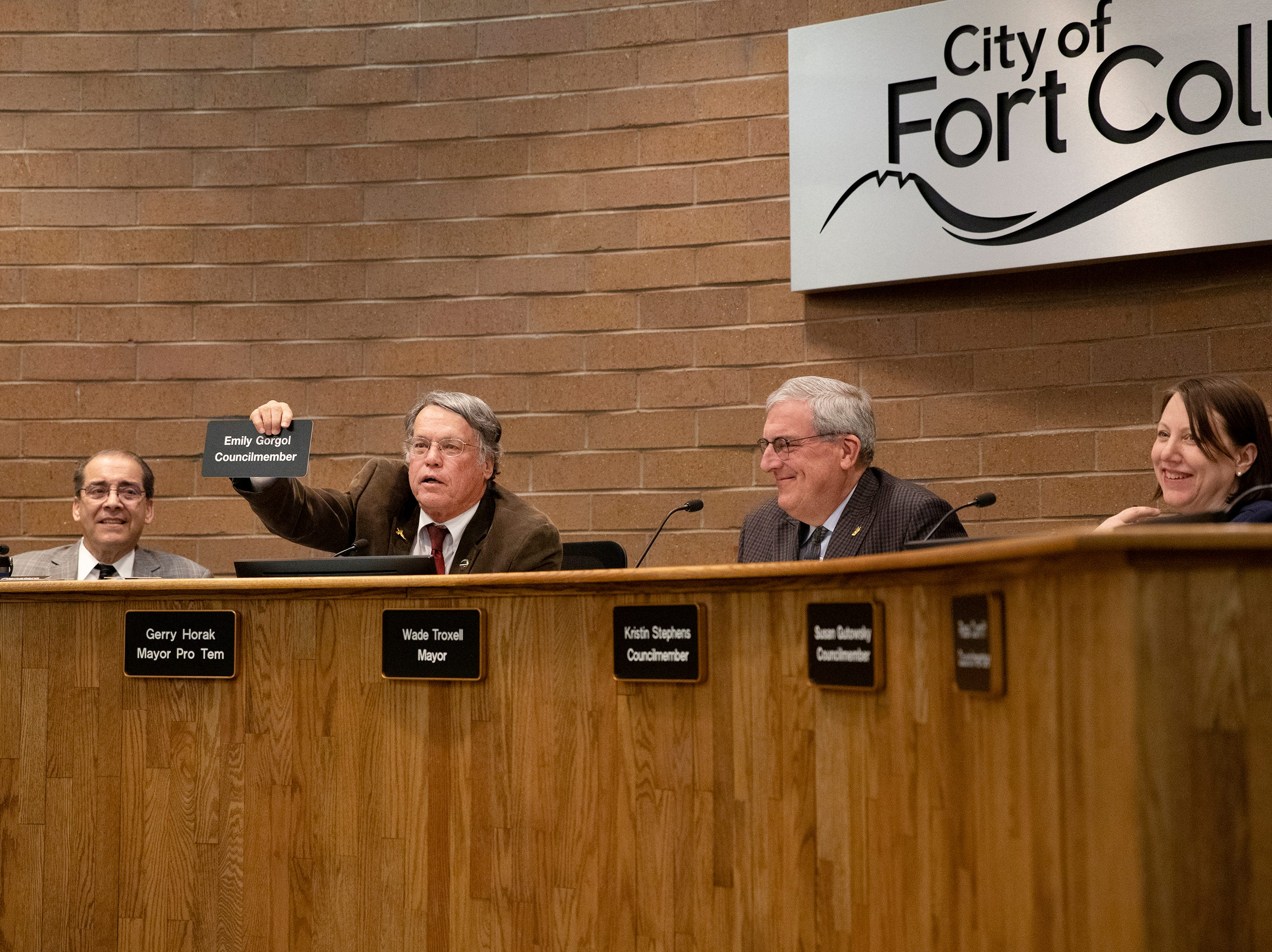 Former City Council member Gerry Horak makes a joke about Emily Gorgol taking his seat on the City Council during his outgoing remarks at City Hall on April 23.