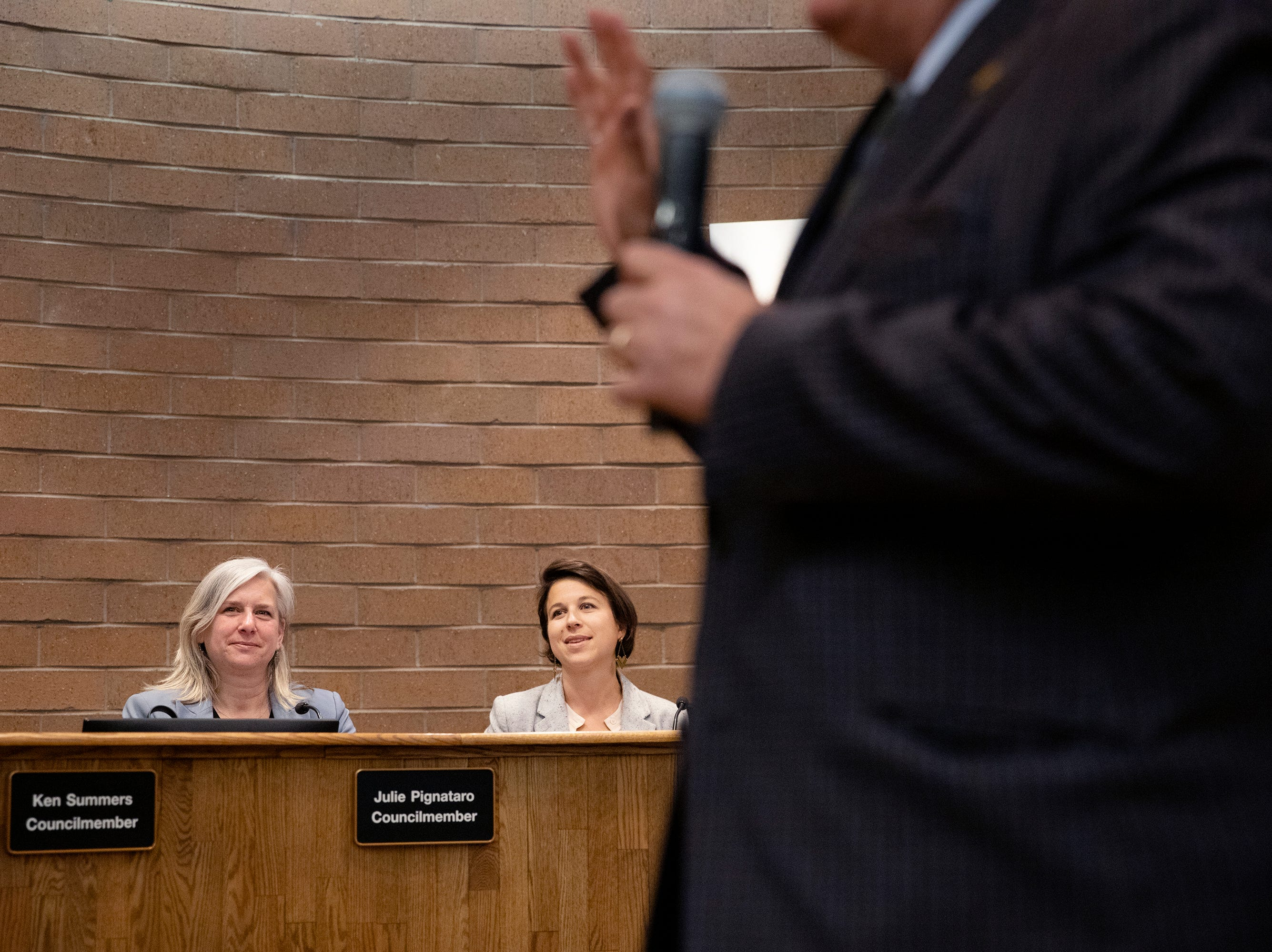 From left, new council members Julie Pignataro and Emily Gorgol watch as Mayor Wade Troxell is sworn in for his third term.