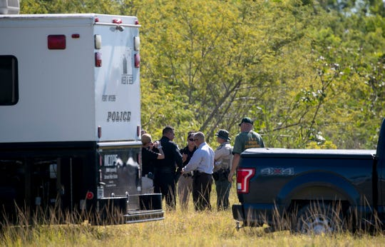 The Fort Myers Police Department investigates in a field off Veronica Shoemaker Boulevard on Wednesday, April 24, 2019, in Fort Myers.