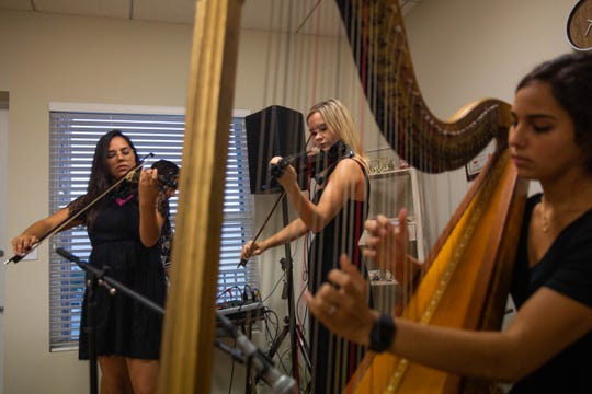 The band Jade Strings performs at the Neubek Photographers studio in Naples on Friday, April 19, 2019.