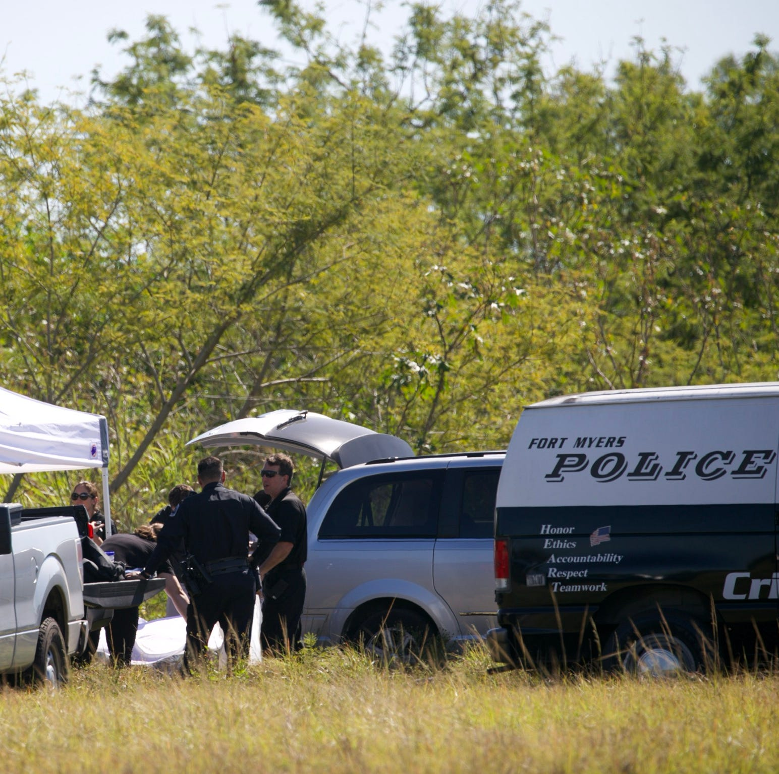 Fort Myers police remove body from small lake near Veronica Shoemaker Boulevard in Fort Myers