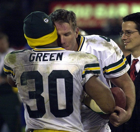 Green Bay Packers quarterback Brett Favre, right, is hugged by teammate Ahman Green at the end of Green Bay's 41-7 victory over the Oakland Raiders on Dec. 22, 2003, in Oakland, Calif. Favre's father, Irvin Favre, died the day before. (AP Photo/Marcio Jose Sanchez)
