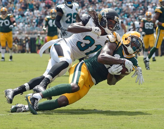 Green Bay Packers wide receiver Davante Adams (17) makes a touchdown catch in front of Jacksonville Jaguars cornerback Davon House (31) during the first half Sunday, Sept. 11, 2016, at EverBank Stadium in Jacksonville, Fla.
