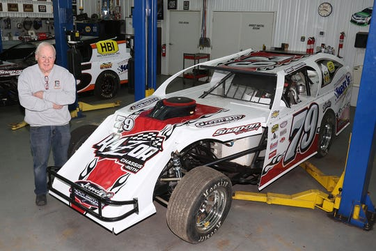 Green Bay's Jerry Muenster, who'll be 78 in May, poses next to his IMCA modified racer he plans to race at Shawano Speedway and Outagamie Speedway in Seymour in 2019.