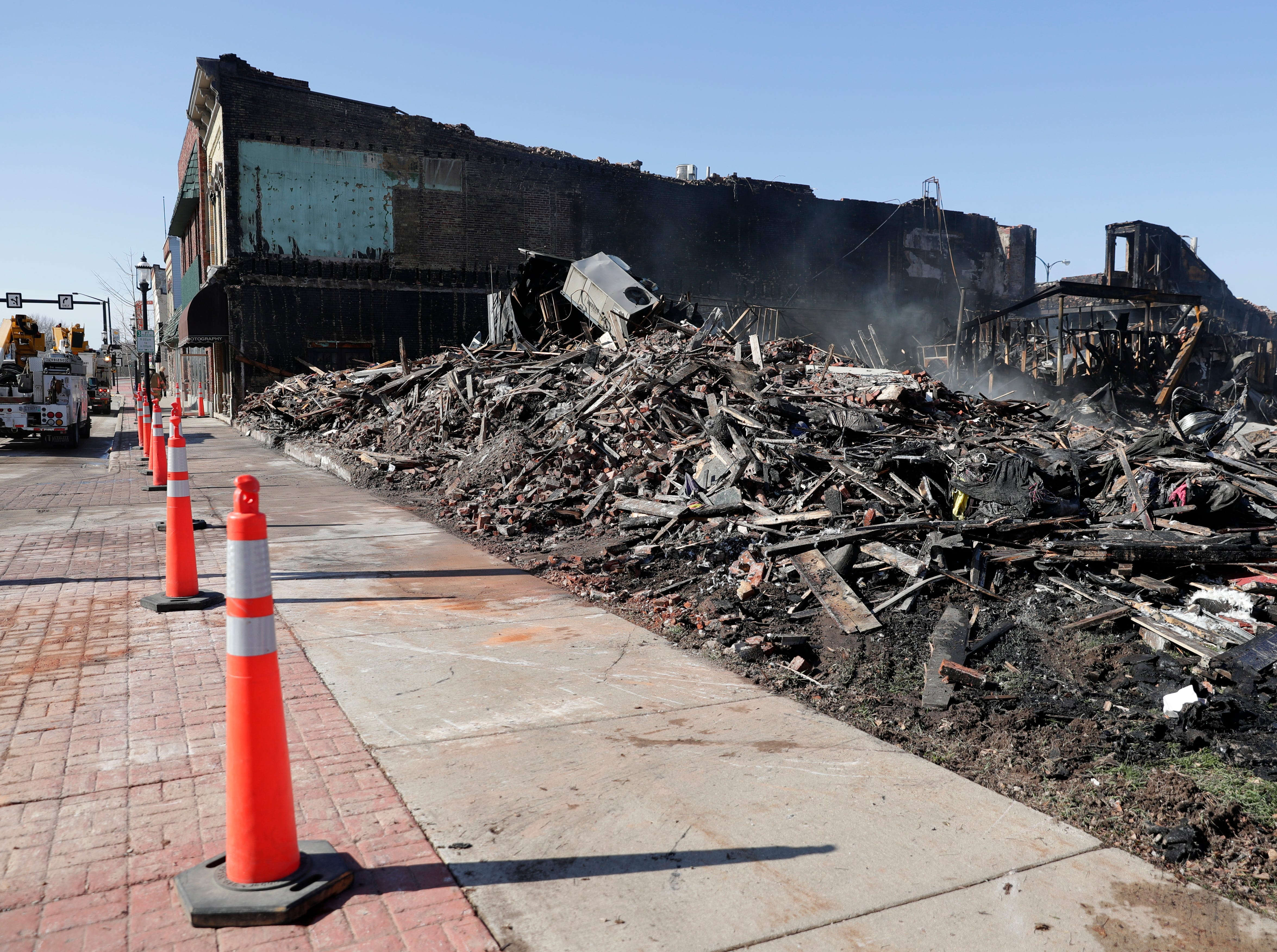The remains of 100 S. Broadway in De Pere continue to smolder on April 24, 2019 after the building burned down overnight. The building was home to Ogan Restaurant, apartments and a number of other businesses.