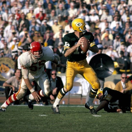 Green Bay Packers quarterback Bart Starr (15) in action against the Kansas City Chiefs during Super Bowl I on Jan. 15, 1967, at the Los Angeles Coliseum in the first ever meeting of the AFL vs NFL World Championship.  The Packers defeated the Chiefs 35-10. Mandatory Credit: Darryl Norenberg-USA TODAY Sports