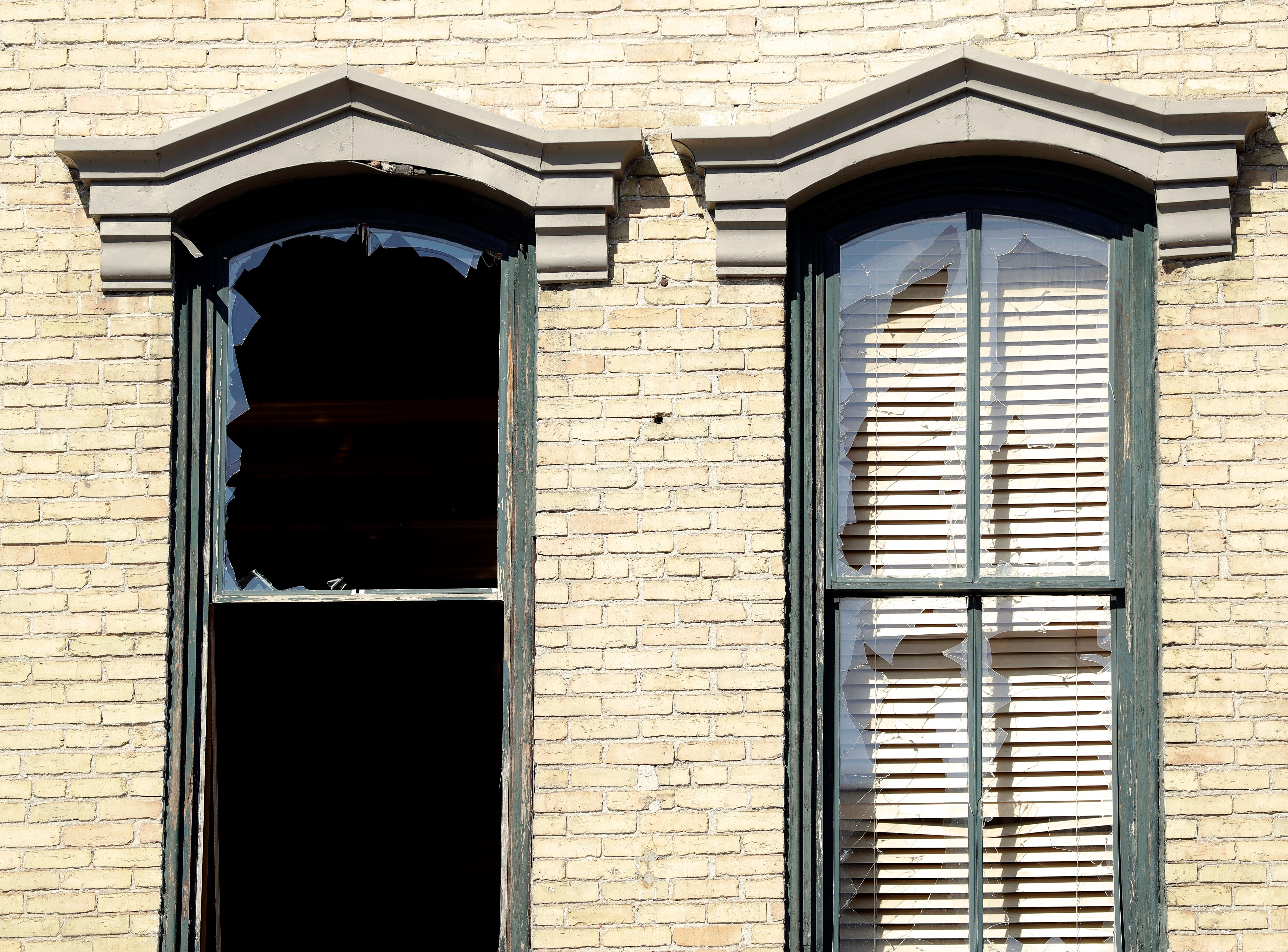 Broken windows in the building next to 100 S. Broadway in De Pere, which burnt down on April 24, 2019.