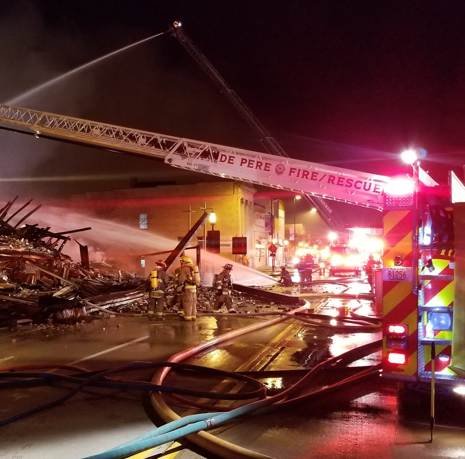Fire destroys historic De Pere building, several businesses, displaces over 20 people