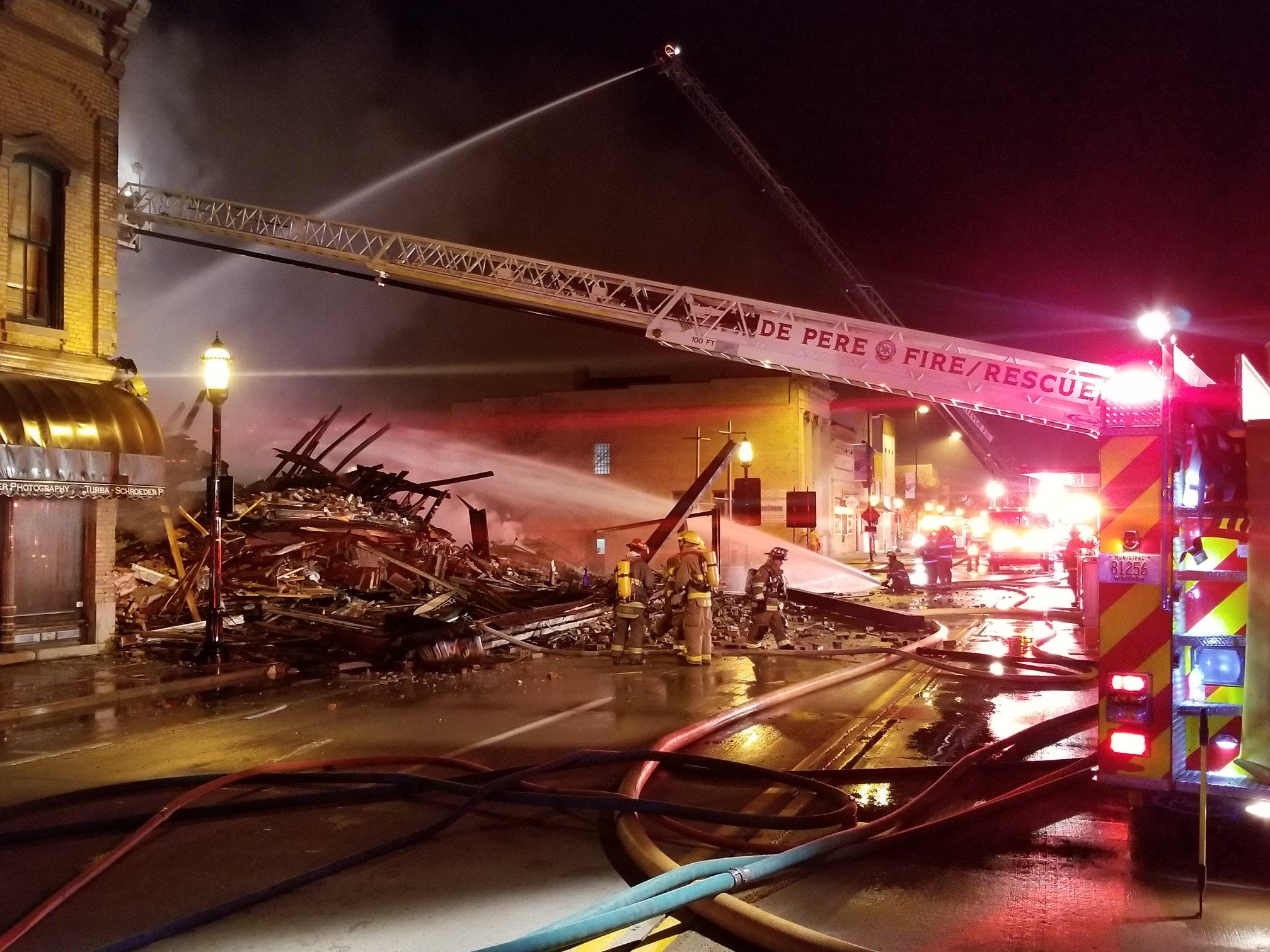 Crews work to put out a fire in the 100 block of South Broadway Street in downtown De Pere.