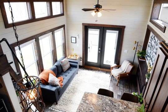 The living area as seen from a loft inside a model tiny home at the Lake Walk Tiny Home Community in Greer.