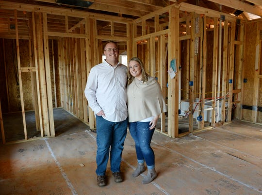 Drew and Natalie Robertson inside their new 600 square feet home that is currently under construction.