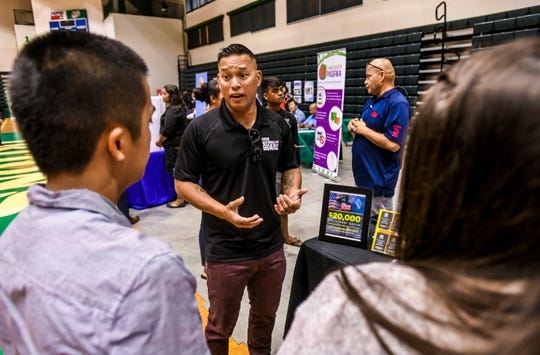 Job seekers attend the University of Guam Job Fair, hosted by University of Guam's Career Development Office, at the Calvo Field House in Mangilao April 24.