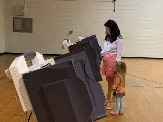 A woman casts her ballot in the Hattiesburg 1% sales tax referendum Tuesday, April 23, 2019, at Thames precinct. The measure passed with 81% of voters' approval.