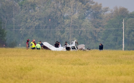 Emergency personnel at the scene of a small plane crash that claimed the lives of two people at the Henderson City-County Airport Wednesday, April 24, 2019.