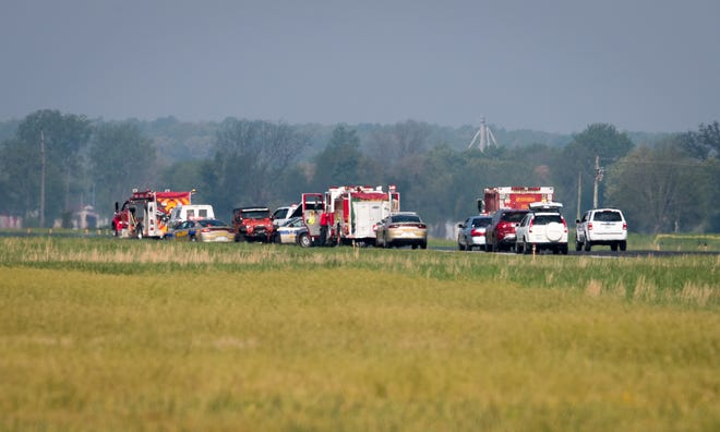 Rescue vehicles on the runway at the Henderson City-County Airport after a small plane crash claimed the lives of two people Wednesday morning, April 24, 2019.