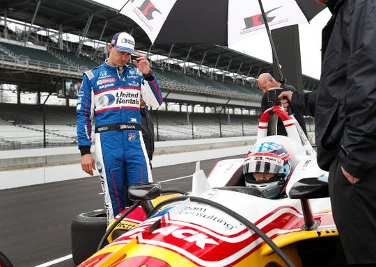 Rahal Letterman Lanigan Racing driver Graham Rahal at his teammate driver Takuma Sato, right, as he sits in his car during testing for the Indianapolis 500 at the Indianapolis Motor Speedway on Wednesday, April 24, 2019.