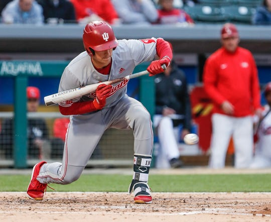 Indiana University Hoosiers outfielder Matt Gorski (7), bunts during a game between the Indiana University Hoosiers and Ball State Cardinals, at Victory Field in Indianapolis on Tuesday, April 23, 2019.