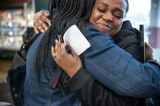 """Latasha Sanders (right) hugs IndyStar columnist Suzette Hackney after catching up in a Speedway, Ind., Kroger on Thursday, April 18, 2019. """"I'm happy thgat people are responding to my story,"""" said Latasha. """"It just makes me feel good that I didn't give up. I just kept pushing, kept pushing. And there's people actually responding to give me advice. It will get us to where we need to be."""""""