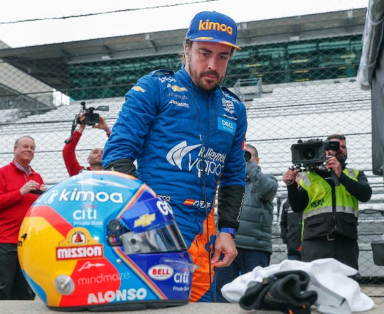 McLaren Racing's Fernando Alonso prepares to get in his car during NTT IndyCar Series open testing for the Indianapolis 500 at the Indianapolis Motor Speedway on Wednesday, April 24, 2019.