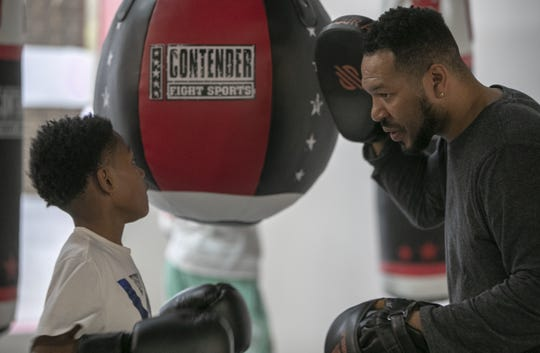 Christian Allen, 10, works at Ced's Boxing Academy, with multiple-time Indiana Golden Gloves champion Cedric Johnson, who has been a boxing instructor and promoter locally, Indianapolis, Wednesday, April 24, 2019. The Indiana Golden Gloves finals are on Thursday, and Johnson is looking forward to attending, and hopes his newly-opened gym will produce a champion within the next year or two.
