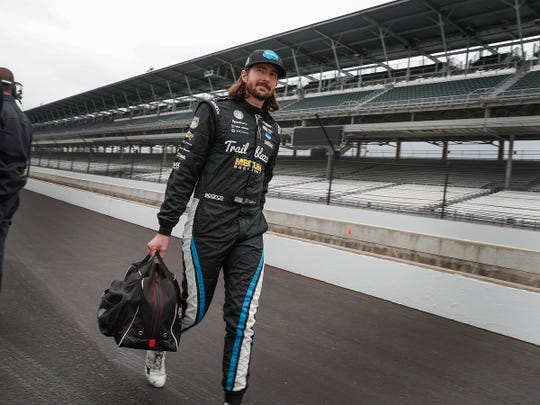 Dreyer & Reinbold Racing's JR Hildebrand talks down pit road during NTT IndyCar Series open testing for the Indianapolis 500 at the Indianapolis Motor Speedway on Wednesday, April 24, 2019.