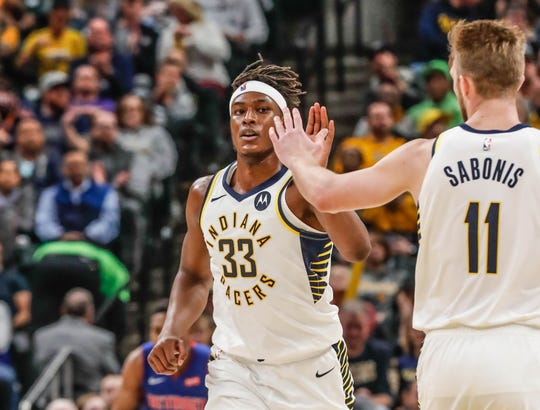 The Pacers' future likely won't include both center Myles Turner (33) and forward Domantas Sabonis (11), Gregg Doyel writes.