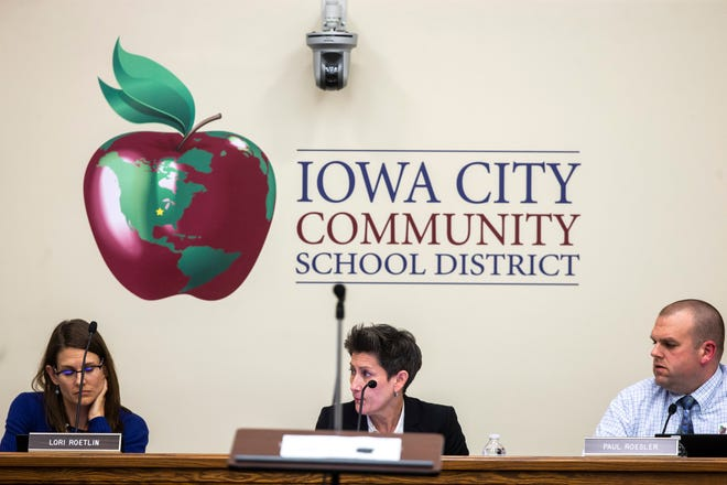 School board members Lori Roetlin, from left, president Janet Godwin, and vice president Paul Roesler, are pictured during a school board meeting, Tuesday, April 23, 2019, at the Iowa City Community School District (ICCSD) offices in Iowa City, Iowa.