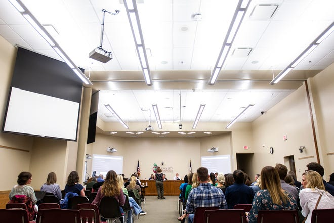Members of the public speak during a school board meeting, Tuesday, April 23, 2019, at the Iowa City Community School District (ICCSD) offices in Iowa City, Iowa.