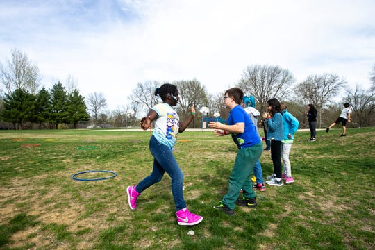 """Students participate in an activity led by Kirk Ryan, a fifth-grade teacher, titled """"healthy life stars"""" during a Lucas on Campus (LOC) after school program, Tuesday, April 23, 2019, at Robert Lucas Elementary in Iowa City, Iowa."""