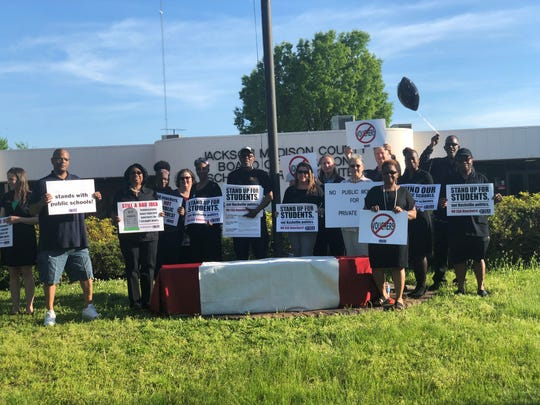 The Tennessee Education Association, the Jackson-Madison County Education Association, and community members protested the school vouchers bill making its way through the Tennessee General Assembly, on Monday, April 24, 2019, in front of the JMCSS central office.