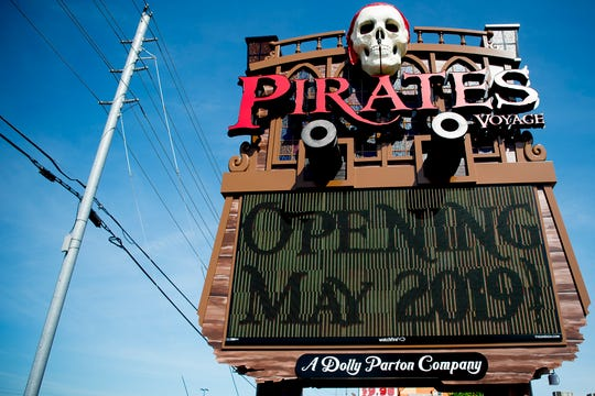 The Pirates Voyage sign stands on the Parkway in Pigeon Forge, Tennessee on Wednesday, April 24, 2019. The $9 million, 30,000 square foot arena features three pirate ships, an indoor water stage and a cast of two dozen aerialists, divers, dancers and singers. The show is slated to open May 24 with a grand opening June 7.