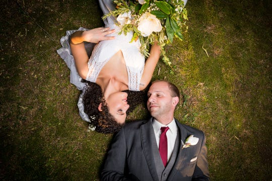 A little backdrop creativity can make a big difference at an eco-friendly wedding. Brittany Crocker and her husband, Matt Willis, relied on existing flowers, ivy, stones and even the ground for photos and wedding decorations.
